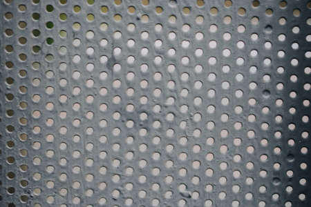 Detailed texture background gray sheet metal perforated. Steel plate with holes Stock fotó