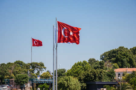 Red Turkish flags with blue sky on the background.