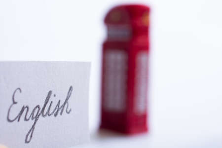 Notepaper with English wording near the British telephone booth