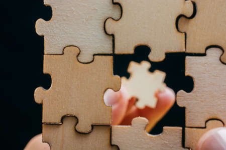 Piece of jigsaw puzzle as business strategy problem solving concept