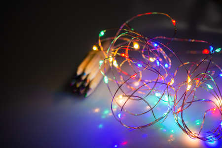 Colored pencils for creative idea and concept behind christmas lights