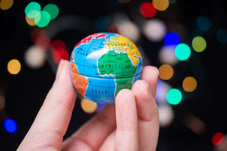 World globe  model in hand.   Global business  and ecology concept.