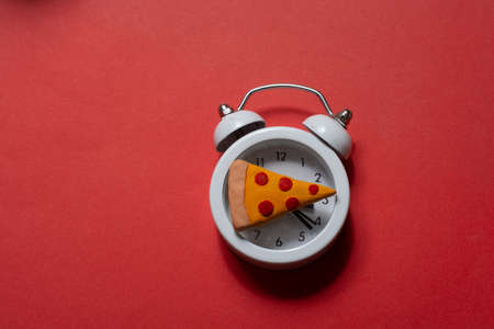 Pizza and alarm clock.  Pizza time. Creative design for menu, cafe, restaurant. Stock Photo
