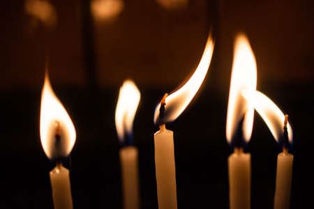 Candle lights in the darkness. Abstract candles background. Hope, fire. Stock Photo