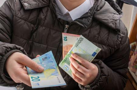Hands giving  euro banknotes currencies as  financial activity Фото со стока