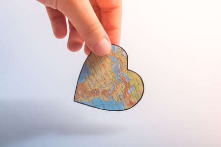 heart shaped object with map of Africa as valentine concept in hand