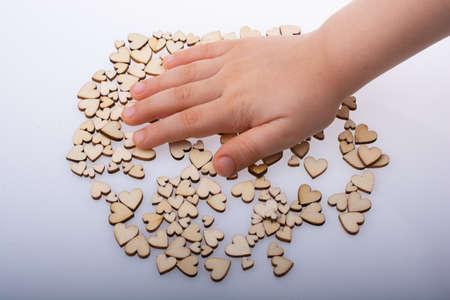 Retro style wooden hearts under hand as love concept Standard-Bild