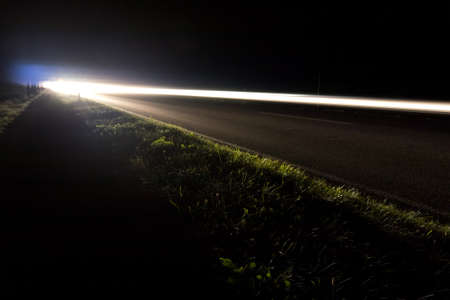 car lights on a road by night