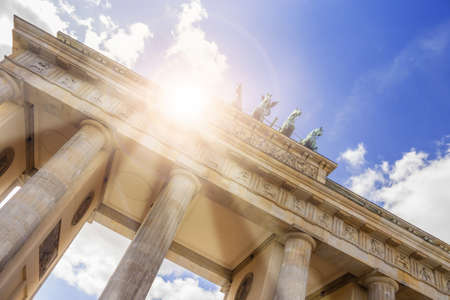 brandenburger tor in berlin with blue sky and lensflare