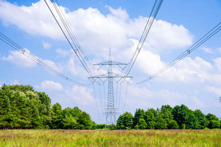 electrical tower in landscape in summer time photo