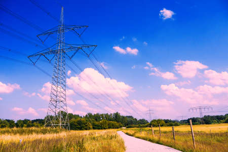 electricity providers: electrical tower in lanscape with blue violet sky in summer
