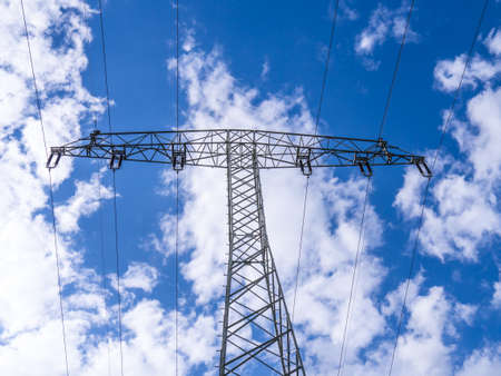 electricity providers: electrical tower and blue cloudy sky