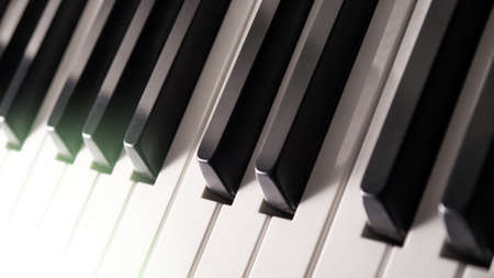 piano keys and light of a headlamp (background) photo