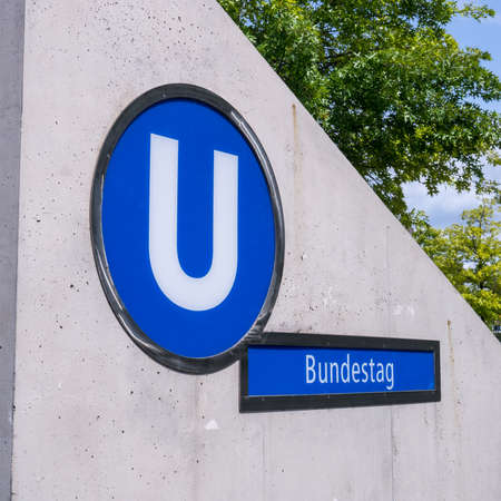 bundestag sign at a subway station in berlin photo