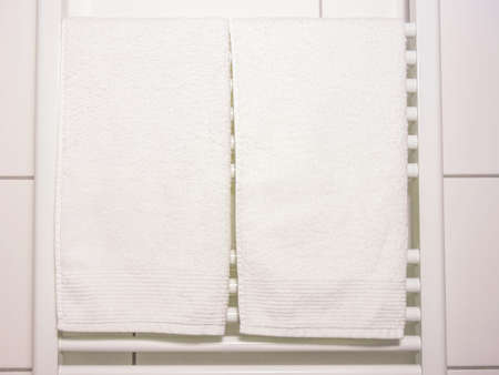 a white towel on heating in bathroom photo