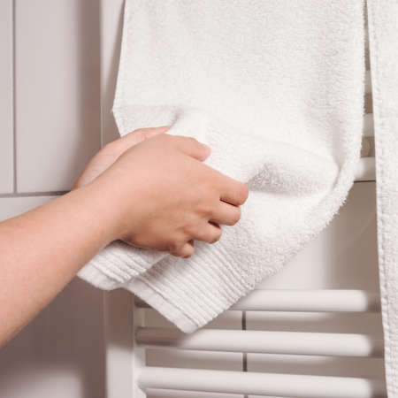 dry hands on towel, heating in background photo