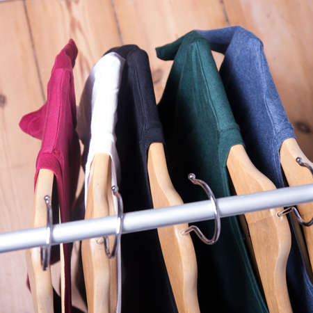 hangers with shirts in different colors photo