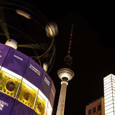 hectic life: World clock and tv tower in berlin by night