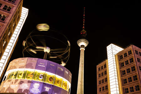 World clock and television tower in berlin by night