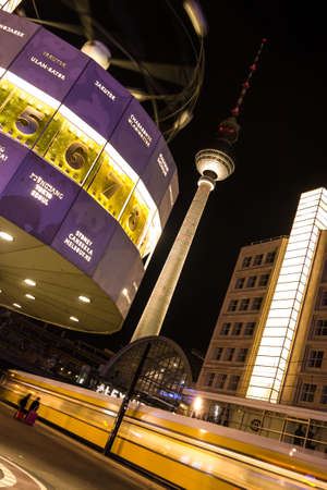 hectic life: World clock, tv tower and train in berlin by night