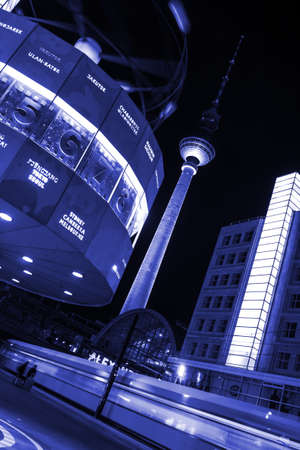 hectic life: World clock and train in berlin by night