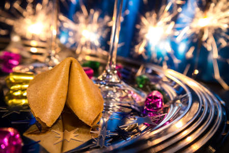 fortune cookie and champagne glass on new year