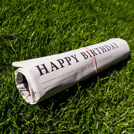 happy birthday paper on green grass