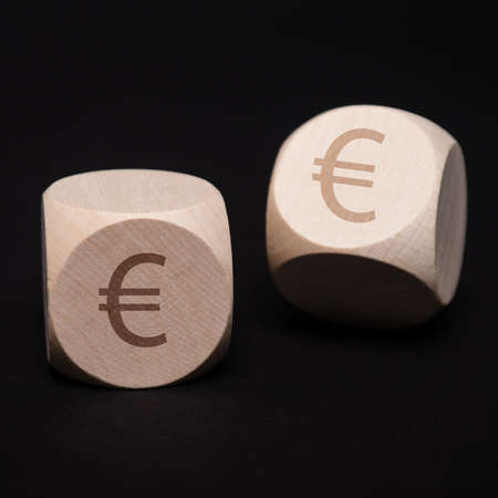 dices with euro symbol on black photo