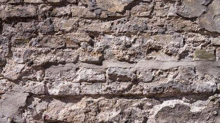 weather beaten: weather-beaten brick wall  sandy look