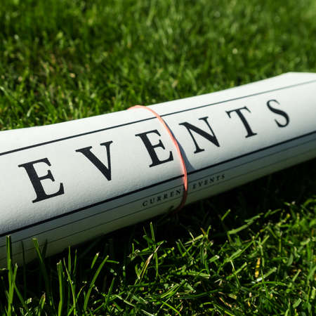lates: event newspaper on a green meadow Stock Photo