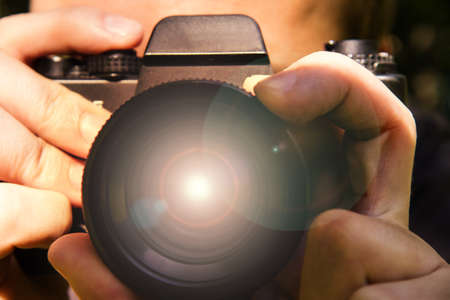 lensflare: photographer and lensflare on camera outdoor Stock Photo