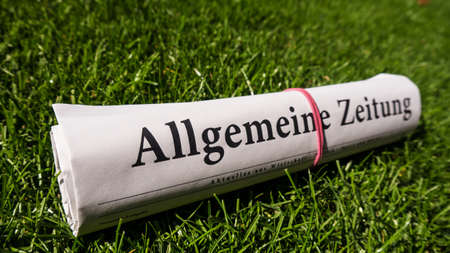lates: general newspaper (allgemeine zeitung) german on meadow Stock Photo