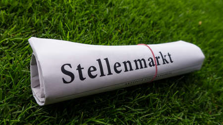 lates: job newspaper (stellenmarkt ) german on meadow Stock Photo