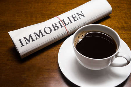 lates: immobilien newspaper (german) and cup of coffee