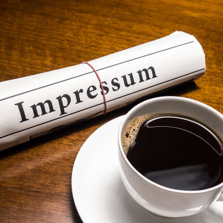 lates: impressum newspaper (german) and cup of coffee