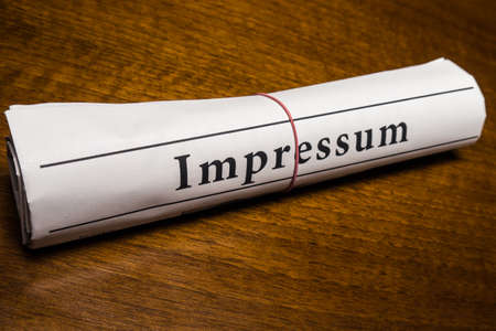 lates: impressum newspaper (german) on desk Stock Photo