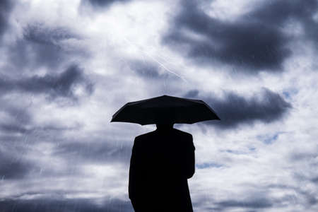 business man and umbrella in storm Stock Photo