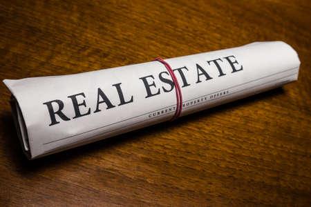 breaking news: real estate newspaper on desk Stock Photo