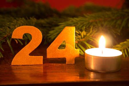 christmas eve: Christmas Eve, candle and branch Stock Photo