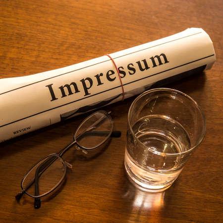 impressum, glass water, glasses on desk photo