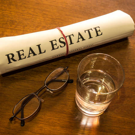 lates: real estate newspaper on desk Stock Photo