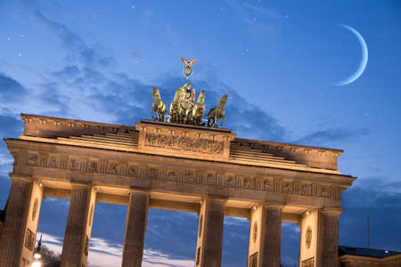 brandenburger tor with moon and stars in berlin photo
