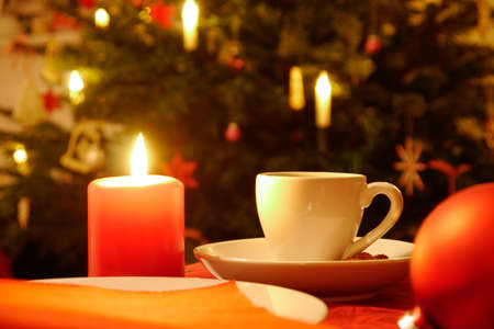 cup of coffe and candle at christmas