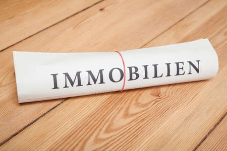'immobilien' newspaper (german) on wood floor photo