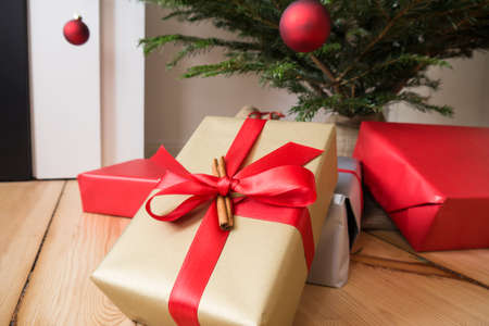 piling: presents and christmas tree on timber piling Stock Photo