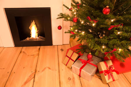 piling: christmas tree and chimney on timber piling Stock Photo