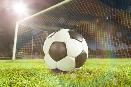 soccer ball near goal and lensflare photo
