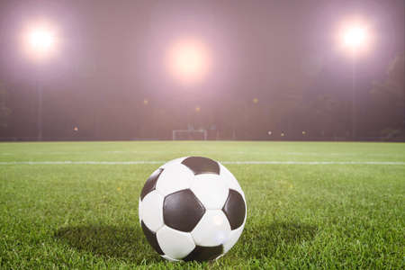 soccer ball on field with light spots photo