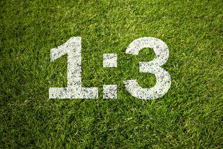 green field with match result Standard-Bild
