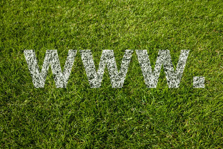 www. text in white letters on meadow Stock Photo